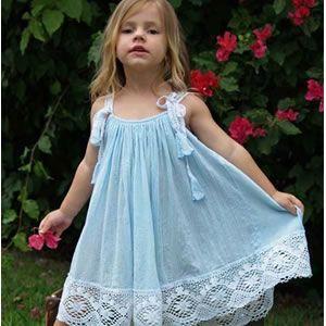 فساتين بتشكيلاتها الرائعة للأطفال hwaml.com_1355655895_468.jpg